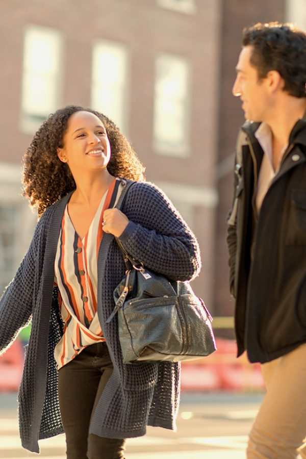 man and woman walking across Harvard University campus