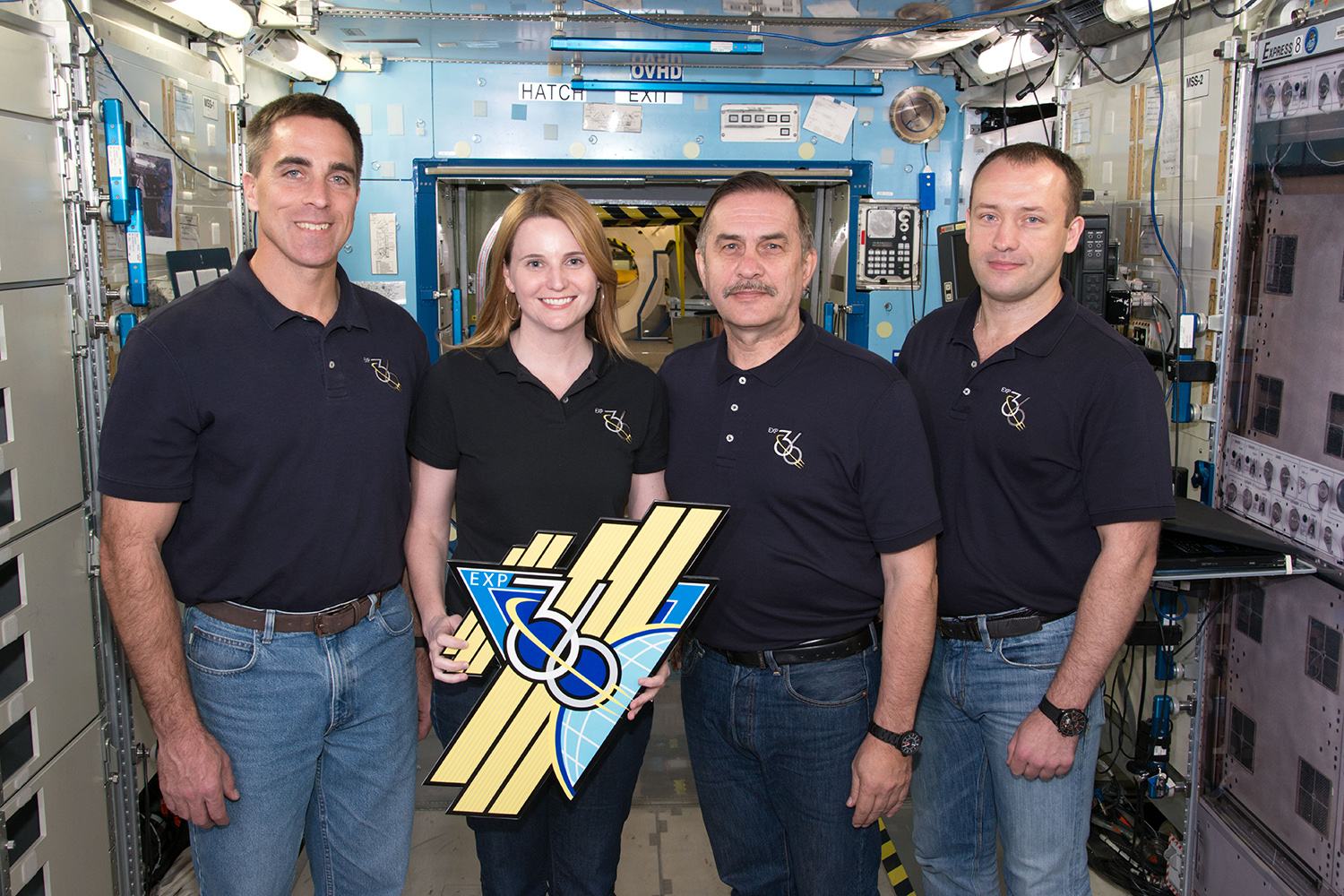 Buchli with three members of the crew of the International Space Station in 2012.